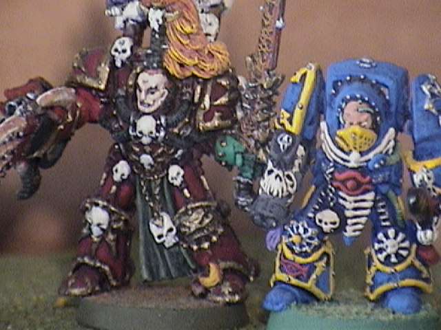 Abadon and a Tzeentch sorcerer of old